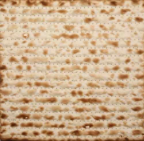 Close cropped picture of 1 piece of matzo.